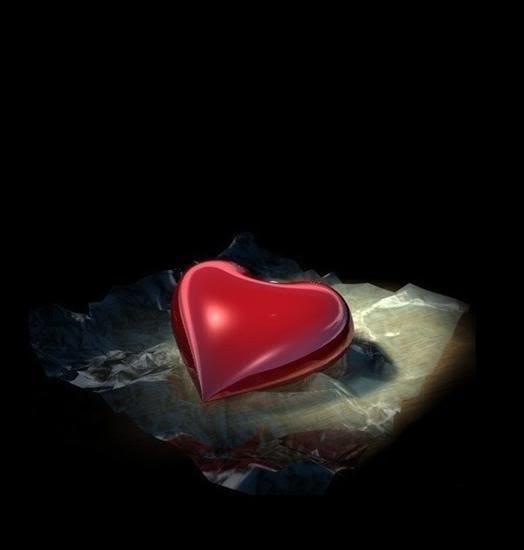 joli coeur rouge sur fond noir