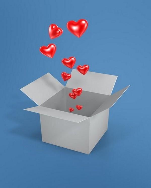 Coeurs rouges qui sortent d'une boite